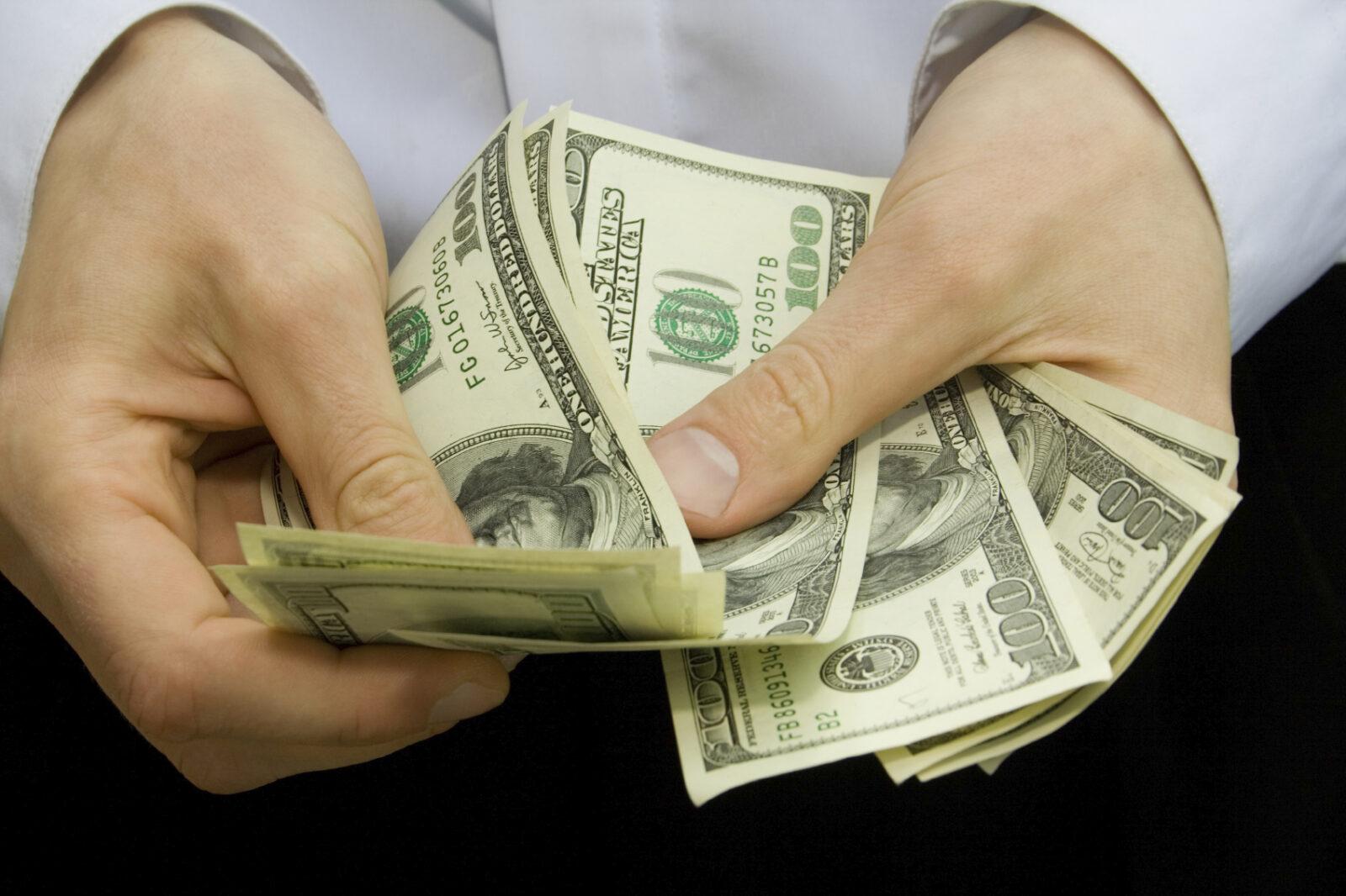 us dollars in hands