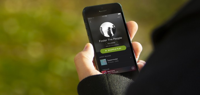 Spotify App in Mans Hand