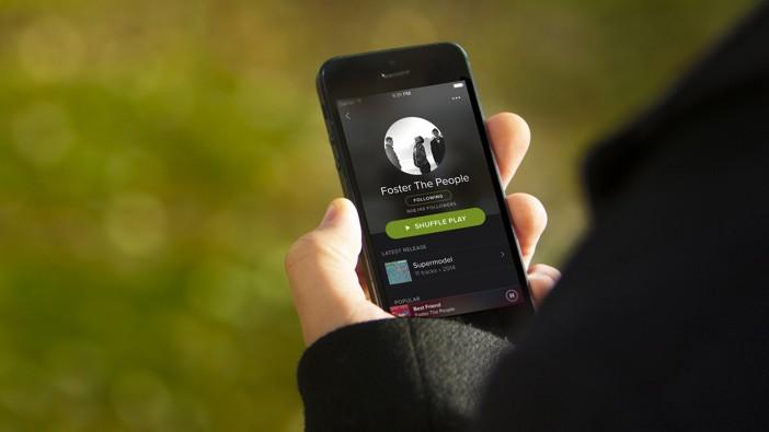 Spotify App in Mans Hand