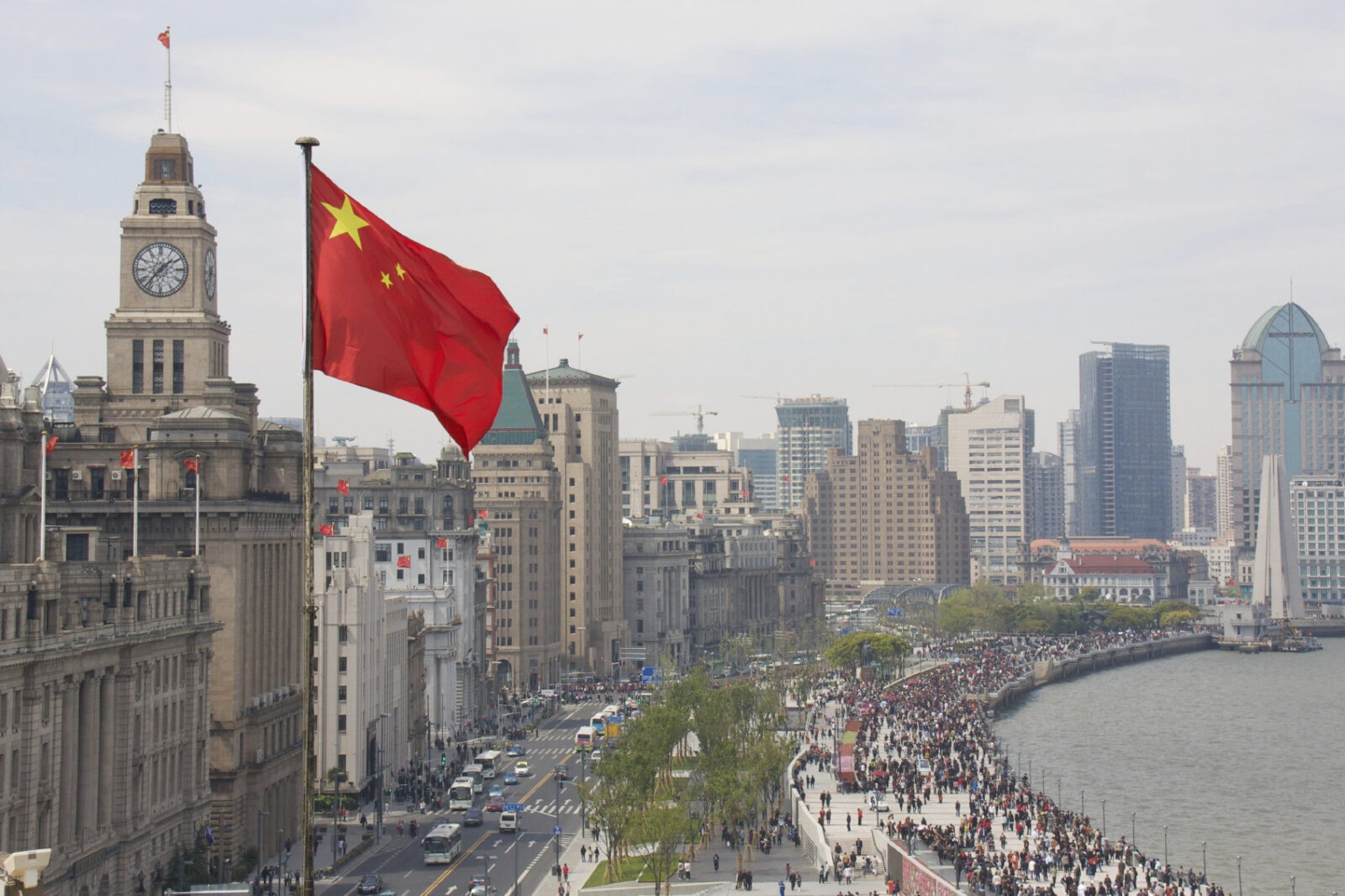 The Bund in China with Chinese Flag