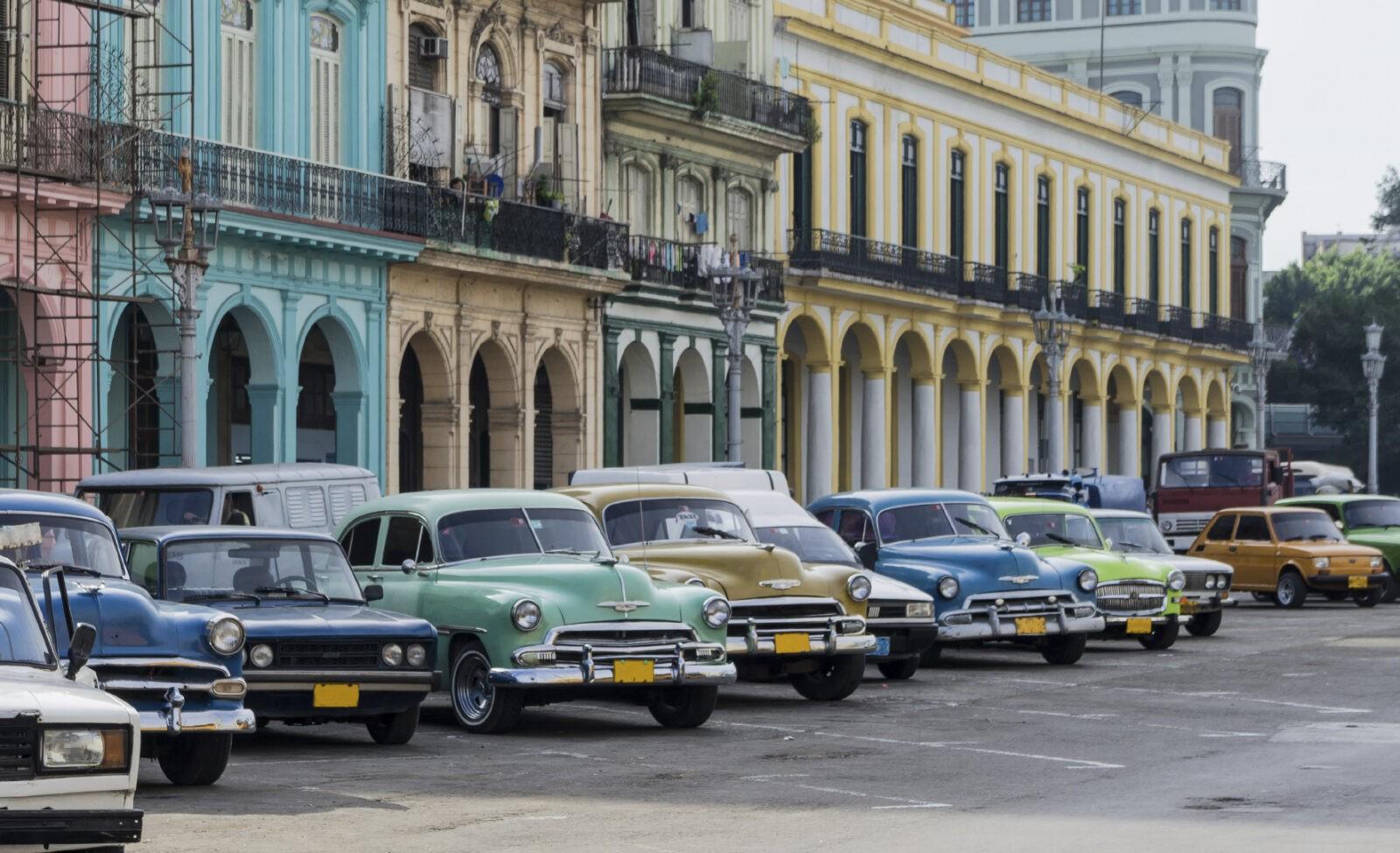 Street scene with vintage car in Havana, Cuba.
