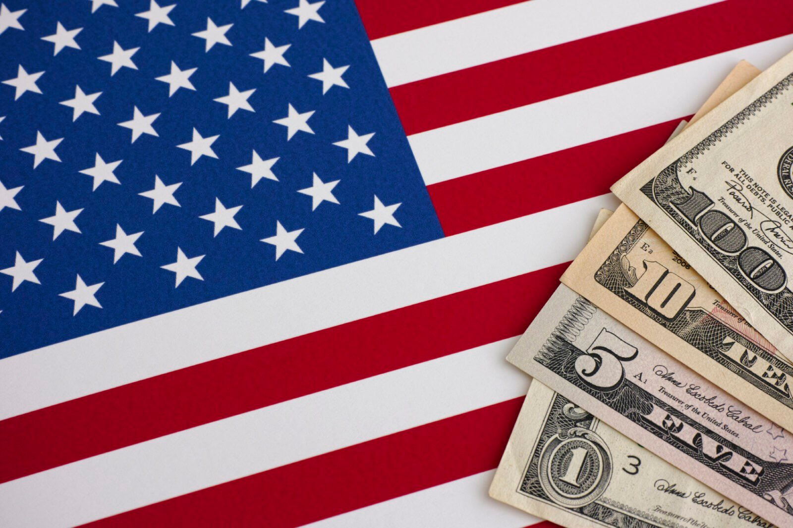 American flag and dollars