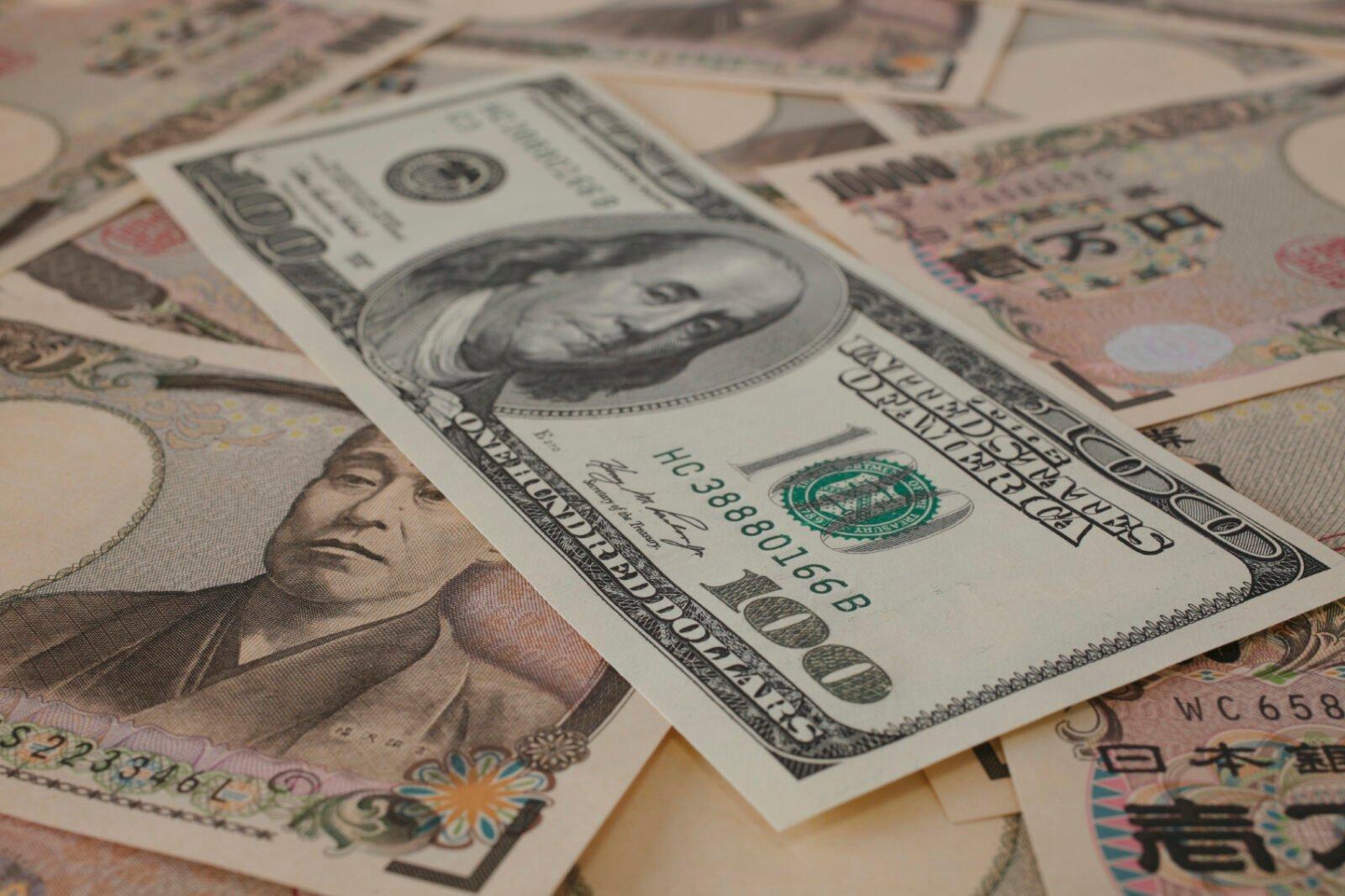 Japanease 10000 yen and 100 Dollar .