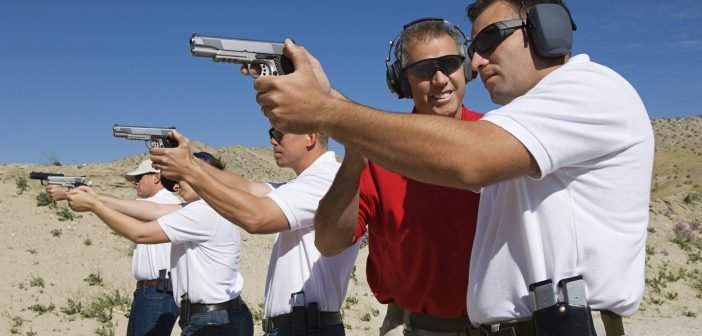 Lieutenant standing with troops holding guns on training