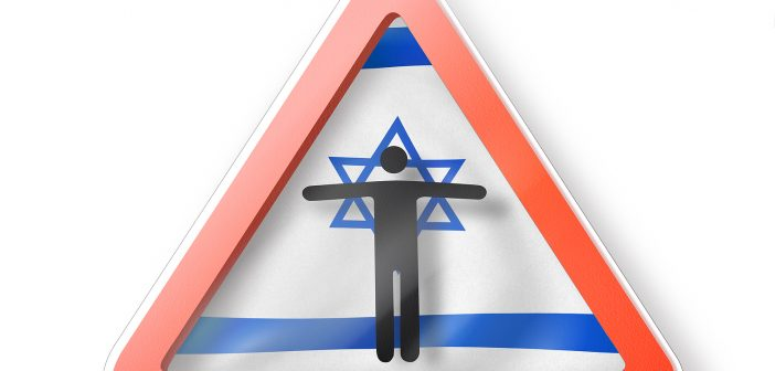 Prohibition sign with black man's figure on the Israeli flag on